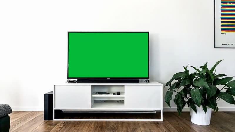 绿屏抠像白色电视柜黑色液晶电视.jpg