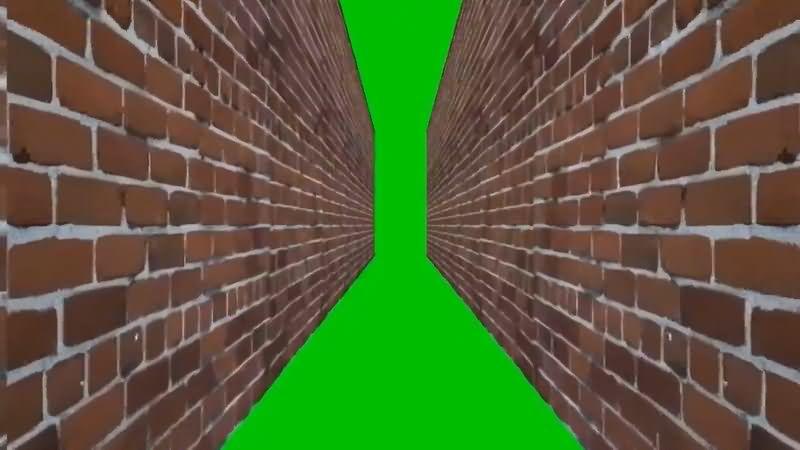 绿屏抠像穿过狭窄的墙壁视频素材